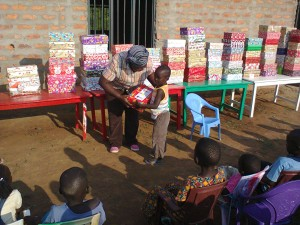 Mama Phoebe handing out Christmas boxes fro Rotary UK