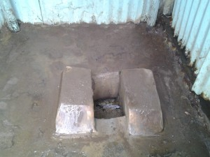 The toilet is full and over flows when the rain is torrential, dangerous for the children